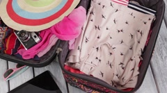 Clothes is filling suitcase up. Stock Footage