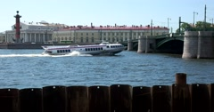 Exchange bridge, Rostral column, boat on Malaya Neva, Saint Petersburg Stock Footage
