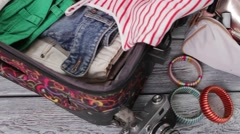 Camera near suitcase with clothes. Stock Footage
