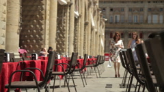 Two Women reaching an Open Air Cafeteria in Piazza Maggiore, Bologna Stock Footage