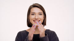 Portrait of young pretty girl rejoicing and surprised. Slow motion Stock Footage