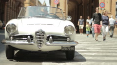 Vintage Giulietta Spider Alfa Romeo parked in the old town of Bologna Stock Footage