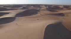4x4 driving across dunes in desert 2 Stock Footage