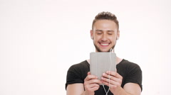 Portrait of young handsome man speaking on tablet. Slow motion - stock footage