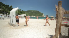 Boys and Girls under beach shower in Sirolo Stock Footage