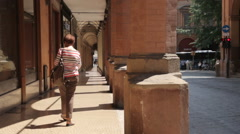 A mature woman walks in an elegant street in Bologna Stock Footage