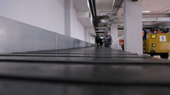 Dog training dog airport checks luggage carousel Stock Footage