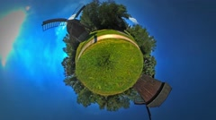 Little Tiny Planet 360 Degree Mills on the Field a Fire Road Rustic Houses in Stock Footage