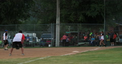 Softball game rural community hit out at first DCI 4K Stock Footage