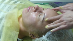 Cosmetologist doing massage of female face. Close-up. Stock Footage