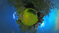 Little Tiny Planet 360 Degree Man on the Backyard Rustic Houses in the Stock Footage