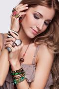 Beautiful woman in jewelry and  bijouterie Stock Photos
