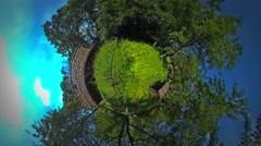 Little Tiny Planet 360 Degree Beehives and Barns in Garden Trees Supply a Nice Stock Footage