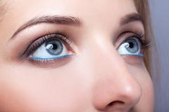 Closeup shot of female eyes with day makeup - stock photo