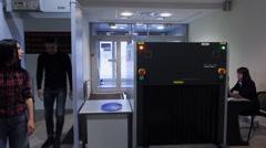 Pair of passengers passes custom control in airport Stock Footage