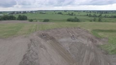 4k aerial fly over bull dozers working in field Stock Footage