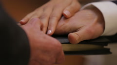 Priest's hands blessing bride and groom in church Stock Footage