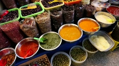 Market in South Ameirca, Peru with Dry fruits, olive and sauces Stock Footage