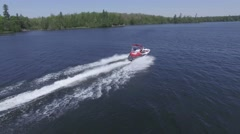 4k aerial follow police boat on lake Stock Footage