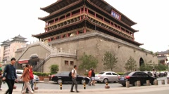 People walk in front of the Drum tower in Xian, China. Stock Footage