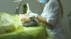 Beautician making permanent makeup of eyelash. Master works with the eyebrows Stock Footage