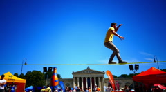 Active Sportsman competing Slackline King's, square Munich Germany Europe Stock Footage