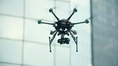 Six Rotor Drone with Camera on Gimbal flying in the Sky. Shot in Slow motion. - stock footage