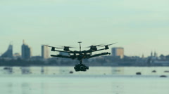 Six Rotor Drone with Camera on Gimbal flying in the Sky. Shot in Slow motion. Stock Footage