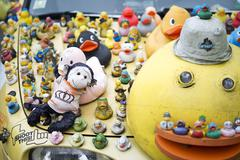Many rubber ducks on car Stock Photos