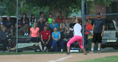 Softball woman swing and hit at home plate DCI 4K Stock Footage