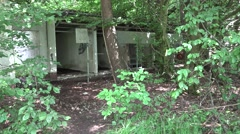 Four Special Soldiers controll outside some bedraggled kennels. Shot is ungraded Stock Footage