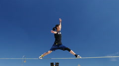 Slow Motion Active Sportsman competing Slackline King's, square Munich Germany Stock Footage