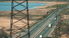 Electric poles in barren wasteland near the high way in Ukraine Stock Footage