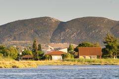 Traditional colorful old houses at the wetland of Oropos in Greece. Stock Photos