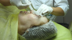 Hands of beautician are preparing the skin for the procedure - stock footage