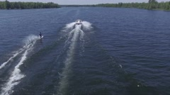 4k aerial water skiing follow view Stock Footage