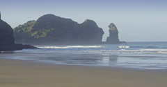 Aerial over beach at piha towards lion rock, Auckland, New Zealand Stock Footage