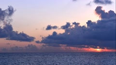 Sunset over the sea. Rays of the sun through the clouds. - stock footage