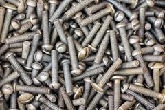 Pile of a metal fixing bolts with thread on background Stock Photos
