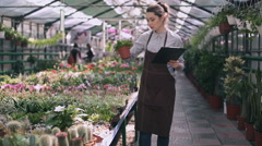 Woman gardener making notes in clipboard Stock Footage