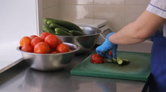 In airport factory the woman is cutting cucumbers and tomatoes in small pieces Stock Footage