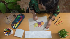 Woman drawing a picture using pastels and watercolor Stock Footage
