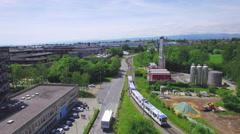 Train entering a futuristic city aerial shot Stock Footage