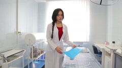 Young woman doctor clinic. Doctor at work in the clinic. - stock footage