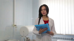 Young woman doctor clinic. Doctor at work in the clinic. Stock Footage