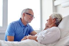 senior couple meeting at hospital ward - stock photo