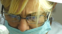 Close up portrait of female doctor in glasses with protective work wear - stock footage