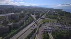 Highway aerial - driving toward the city of Lausanne Stock Footage