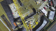 Large crane on a building site cinematic aerial shot Stock Footage