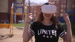Young woman playing game using VR-helmet for smart phones. Virtual space - stock footage